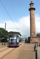 A southbound tram service has just left Fleetwood Ferry on 14 June and passes along Pharos Street on its way to Starr Gate. <I>Flexity</I> 004 is still on the turnaround loop, prior to rejoining the double track section along Fleetwood's main street. <br><br>[Mark Bartlett&nbsp;14/06/2014]