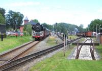 At 12.40 on 14th June the 06.00 charter from Leipzig and Berlin arrives at Putbus in the middle of the annual Railfest - the train is topped by ex-DR 01 0509-8 and tailed by ex-DR diesel 118 770-7. Note standard and narrow-gauge tracks merging in the foreground for the 5.8km dual-gauge final section of the Lauterbach Mole branch. The cost of a return ticket from Leipzig was just 89 Euros (about �75) for a round trip of around 600 miles.<br><br>[David Spaven&nbsp;14/06/2014]