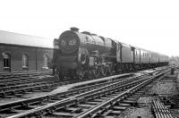 Rebuilt Patriot 4-6-0 no 45534 <I>E Tootal Broadhurst</I> passing Crown Street goods depot on the southern approach to Carlisle on 13 July 1963. The train is the 1S48 summer Saturday 9.20am Manchester Victoria - Glasgow Central which was routed via Hellifield and Kilmarnock.<br><br>[K A Gray&nbsp;13/07/1963]