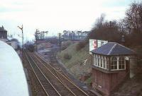 An evening train bound for East Kilbride approaches Clarkston in April 1966, the last week of steam operations on the route. Photographed from the roof car park of Clarkston Toll shopping centre on Busby Road, much of which was destroyed in a major gas explosion five and a half years later, in which 21 people died.<br><br>[John Robin /04/1966]