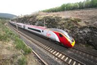 A northbound Pendolino approaching Beattock Summit on 5 May 2014.<br><br>[Ewan Crawford 05/05/2014]