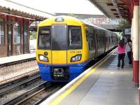 London Overground 378229 calls at  Harrow and Wealdstone (shared with the Bakerloo line) on 28 July with a service for Watford Junction.<br><br>[Bill Roberton&nbsp;28/07/2014]