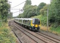 The extra Commonwealth Games traffic has seen Trans Pennine EMUs supplemented by London Midland sets. 350373 is seen here heading south at Barton and Broughton on a Glasgow to Manchester Airport service on 30th July in tandem with TPE 350404.  <br><br>[Mark Bartlett&nbsp;30/07/2014]