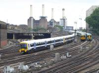 View south from Ebury Bridge of the approaches to London Victoria on 25 July featuring classes 466, 455 and 377.<br><br>[Bill Roberton&nbsp;25/07/2014]