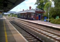 The Worcester platform building at Evesham station on a hot summer Saturday in July 2014 - a well kept station, but with a sparse train service.<br><br>[Ken Strachan&nbsp;26/07/2014]
