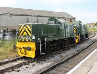 <I>Celebrity</I> Class 14 D9555, the last BR loco built at Swindon works is usually based on the Dean Forest Railway. It ran coupled to D9520 from the Nene Valley on several round trips at the ELR <I>Class 14s @ 50</I> gala on 26th July. The two locos, in smart BR Green livery, are seen running round at Heywood. D9520 ran with a variety of <I>lost loco</I> identities that day including D9544 and D9547 amongst others. <br><br>[Mark Bartlett&nbsp;26/07/2014]