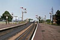 The north end of Manningtree station on 15th August 1976. The semaphores lasted until 1980 and the signal box until 1984. The lorry straddling the tracks is negotiating the level crossing, being too tall for the underpass.<br><br>[Mark Dufton&nbsp;15/08/1976]