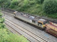 GBRF operated 92043 <I>Debussy</I>, with Eurotunnel markings, emerges from the tunnel under the former 5A Crewe North shed on 29 July with a long rake of STVA empty double deck car carrier wagons.<br><br>[David Pesterfield&nbsp;29/07/2013]