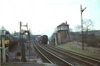 The signalman at Busby prepares to collect the tablet from a standard tank bringing down a train of empty stock from East Kilbride in April 1966.  <br><br>[John Robin&nbsp;/04/1966]