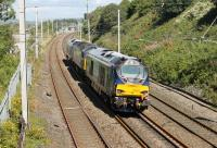 Two new DRS Class 68s, 68006 and 68007 (with Brush Type 4 47841 sandwiched between them), made a transfer run from Crewe Gresty Bridge to Kingmoor on 4th August. The northbound trio is seen here approaching Hest Bank level crossing. <br><br>[Mark Bartlett&nbsp;04/08/2014]