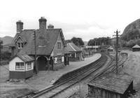 The Mound station in September 1961 looking south along the main line towards Inverness. The station had closed the previous year along with the Dornoch branch, which can just be seen entering the station on the extreme left of the picture. [See image 9749] <br><br>[David Stewart&nbsp;08/09/1961]