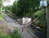 The old Eskbank station looking north east from the A6094 road bridge on 3 August 2014. [See image 48259]<br><br>[John Furnevel&nbsp;03/08/2014]