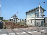 Valley station looking west towards Holyhead in July 2014 showing the original up side building and signal box.  The box controls the level crossing, a crossover at the far end of the station, access to the nuclear flask loading facility and the local semaphore signals.<br><br>[David Pesterfield&nbsp;23/07/2014]