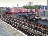 A DLR train curves away from West India Quay towards Stratford on 28 July, while another from either Becton or Greenwich Arsenal passes below.<br><br>[Bill Roberton&nbsp;28/07/2014]