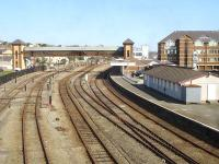 View west over Holyhead station from London Road overbridge on 23 July, showing the rarely used stabling sidings and platform 1, used mainly by Virgin Voyager services from Euston. Three of the Voyagers that stable at Holyhead, plus some Arriva DMUs, use the washing plant, located beyond the footbridge, during overnight servicing. Arriva WAG service stock and class 67 loco are stabled in the sidings over each weekend. The disused building centre right is the former Arriva crew facility and signing on point, now superceded by a new joint crew and customer service facility on platform 2.<br><br>[David Pesterfield&nbsp;23/07/2014]