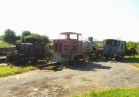 At the south end of the station yard at Llanerchymedd in July 2014 a compound contained two diesel shunting locos, a brakevan, and a tank wagon left over from an abortive line re-opening project.<br><br>[David Pesterfield&nbsp;24/07/2014]