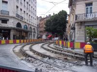 It happens here too! Tramworks underway at Place Grenette, Grenoble, in July 2014. The trams of Lines A and B normally run through here at a high frequency.<br><br>[Andrew Wilson&nbsp;04/07/2014]