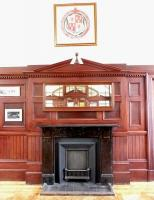 Part of the restored waiting room at Inverurie station in August 2014, complete with GNSR coat of arms hanging above the fireplace.<br><br>[Jim Peebles&nbsp;08/08/2014]
