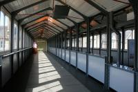 The interior of the 1902 covered walkway at Lancaster  station on a sunny 7th July 2014.<br><br>[Colin McDonald&nbsp;07/07/2014]