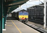DRS 66304 draws into Carlisle platform 1 on 7th August 2014 for a crew change, following which it will resume its journey to Coatbridge Freightliner Terminal.<br><br>[Colin McDonald&nbsp;07/08/2014]