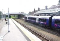 View south at Inverurie station on 8 August 2014 as the 13.33 service for Aberdeen preares to depart.<br><br>[Jim Peebles&nbsp;08/08/2014]