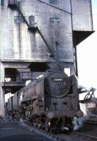 BR Standard class 9F 2-10-0 no 92015 under the coaling plant at Kingmoor shed in October 1966. Built at Crewe in 1954, the locomotive was withdrawn by BR 6 months after this photograph was taken. 92015 was cut up in the yard of Messrs McWilliams, Shettleston, in November 1967.<br><br>[G W Robin&nbsp;08/10/1966]