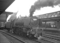 46241 <I>City of Edinburgh</I> stands on the centre road at Carlisle on 25 July 1964. The Pacific is waiting to relieve the incoming locomotive off the 9am Perth - Euston.<br><br>[K A Gray&nbsp;25/07/1964]
