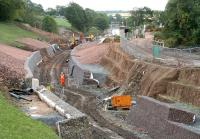 Ongoing work on the trackbed looking south from Lady Brae road bridge, Gorebridge, on 13 August 2014. <br><br>[John Furnevel&nbsp;13/08/2014]