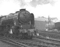 A2 Pacific 60538 <I>Velocity</I> storms out of Newcastle Central with an ECML express heading for the King Edward Bridge in the late 1950s/early 1960s. In the background a BR Sulzer Type 2 awaits its turn on the goods lines with a freight.<br><br>[K A Gray&nbsp;//]