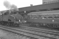 A DMU waiting at the platform at Doncaster in July 1961 alongside Gresley J50 0-6-0T 68928 (with 68917 coupled behind) standing on the centre road.<br><br>[K A Gray&nbsp;29/07/1961]