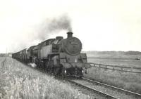 BR Standard class 4 tank 80021 pilots Gresley K2 61782 <I>Loch Eil</I> near Philorth Halt on 9 August 1953 at the head of a lengthy fish train from Fraserburgh. <br><br>[G H Robin collection by courtesy of the Mitchell Library, Glasgow&nbsp;09/08/1953]