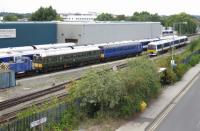 The scene at Chiltern Railways' Aylesbury depot on 15 August 2014 shows a contrast in operational DMU styles, with a 24 year old Class 165 Turbo unit in the company of two 54 year old Class 121 'Bubble Car' units. All are available for service with either 55020 or 55034 used on weekday peak hour Aylesbury to Princes Risborough shuttles.  The diesel shunter is 01509 <I>Lesley</I> (RH 468043).<br><br>[Malcolm Chattwood&nbsp;15/08/2014]