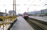 View west at Wurzburg in June 1990 with three types of electric locomotive in the station. From left to right are members of classes 103, 120 and 141. Note the yellow Deutsche Bundespost mail trolleys on the left waiting for the next set of mail bags.<br><br>[John McIntyre&nbsp;/06/1990]