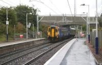 156510 leaves the fully wired Bargeddie station on 21 August 2014 and passes under the completed A752 road bridge heading toward Whifflet. [See image 47157]<br><br>[Colin McDonald&nbsp;21/08/2014]