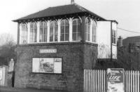 The signal box at Giffnock in 1960, complete with advertisement for the north side <I>Blue Trains</I>.  <br><br>[David Stewart&nbsp;//1960]