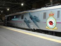 East Coast 91110 <I>Battle of Britain Memorial Flight</I> stands at the western end of platform 2 at Edinburgh Waverley on 14 July 2014 prior to propelling the 17.00 to Kings Cross.<br><br>[David Pesterfield&nbsp;14/07/2014]