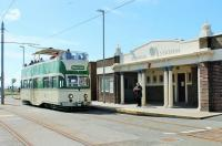 August Bank Holiday means Heritage trams in Blackpool. Open top <I>Balloon</I> 706 <I>Princess Alice</I> has just arrived at Bispham station and is now drawing forward to reverse and return to Pleasure Beach. <br><br>[Mark Bartlett&nbsp;23/08/2014]