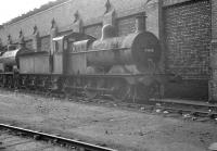 Johnson ex-LMS 3F 0-6-0 no 43618, stored in the sidings alongside Llandudno Junction shed in April 1963. The 1899 veteran, which had been withdrawn from 6K Rhyl more than a year earlier, was finally broken up at Cashmore's scrapyard, Great Bridge, two months after the photograph was taken.<br><br>[K A Gray&nbsp;01/04/1963]