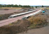 The platforms of Shawfair station on Sunday 24 August 2014 looking south, with ballast now laid along the formation and levelling of the car park area underway on the left.<br><br>[John Furnevel&nbsp;24/08/2014]
