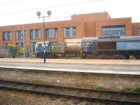 DRS 66431 stabled alongside a Network Rail MPV on 11 March 2014 in sidings by the new Area Operating Centre at the west end of York Station. <br><br>[David Pesterfield&nbsp;11/03/2014]