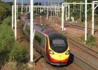 The 1840 Pendolino from Glasgow Central passes Newton West Junction at speed on a Bank Holiday Monday in August 2014. Engineering works at Watford mean the service will terminate at Milton Keynes on this occasion.<br><br>[Colin McDonald&nbsp;25/08/2014]