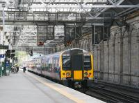 TransPennine 350410 draws to a halt beyond the crossover separating platforms 11 and 7 at Edinburgh Waverley on 22 August 2014. The train is the terminating 10.00 ex-Manchester Aiport.<br><br>[John Furnevel&nbsp;22/08/2014]