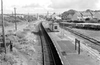 Looking over Bugle station on the Newquay branch in the 1970s.  View is south east towards Par from the A391 road bridge. [Ref query 12924]<br><br>[Ewan Crawford Collection&nbsp;14/09/1976]