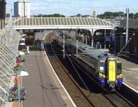 ScotRail 380003 stands in the sunshine at Ayr station's platform 4 on 26 August 2014.<br><br>[John Steven&nbsp;26/08/2014]