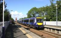 An Edinburgh-bound class 170 rushes through Dalmeny station on 26 August.<br><br>[Colin Miller&nbsp;26/08/2014]