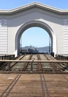 Pier 43 and its Headhouse in the Port of San Francisco. Built in 1914 by the Belt Railroad for loading train-ferries. Through the arch is the Liberty ship, <I>SS Jeremiah O' Brien</I>, moored at Pier 45. Launched in WW11, still very much seaworthy and powered by reciprocating triple expansion steam engines.<br><br>[Brian Taylor&nbsp;20/04/2014]