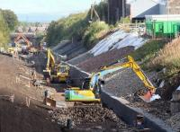 Waverley trackbed alongside the Lady Victoria site on 30 August 2014, with Newtongrange station taking shape this side of the A7 road bridge in the background.<br><br>[John Furnevel&nbsp;30/08/2014]