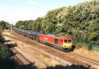 DBS 60010 heads east at Lostock Hall Junction on 27 August 2014 with the empty tar tank wagons returning to Lindsey Oil Refinery on Humberside.<br><br>[John McIntyre&nbsp;27/08/2014]