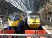 First Hull Trains Adelante unit 180113 alongside an HST at Kings Cross on 30 July 2014.<br><br>[Bill Roberton&nbsp;30/07/2014]