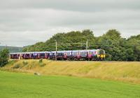 A pair of TransPennine Express EMUs, 350403/408, running through the Lancashire countryside between Garstang and Brock on 13 July 2014 with a Sunday Edinburgh to Manchester Airport service.<br><br>[Mark Bartlett&nbsp;13/07/2014]